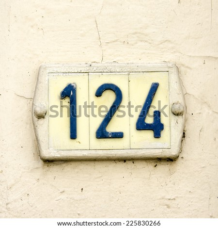 plastic house number one hundred and twenty four. - stock photo