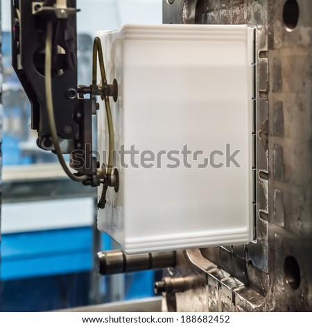 Plastic Injection molding machine working in factory - stock photo