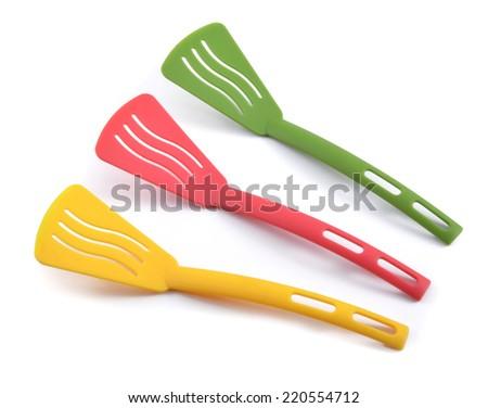 Plastic kitchen spatulas isolated on white - stock photo