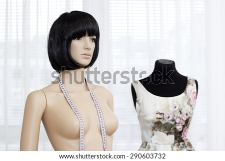 Plastic Mannequins woman  in a design studio. - stock photo