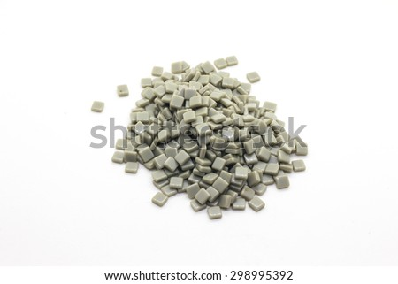 Plastic mosaic tile on white background - stock photo