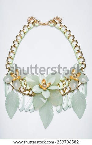 plastic necklace. beige flower - stock photo