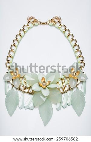 plastic necklace. beige flower - stock photo