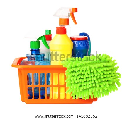 Plastic orange basket with cleaning supplies, isolated on white background - stock photo