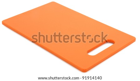 Plastic Orange Cutting Board Over White Background - stock photo
