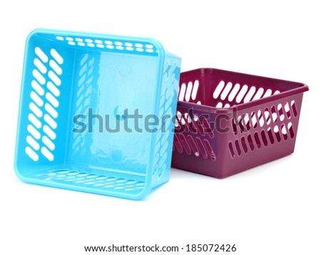 Plastic organizing basket on a white background