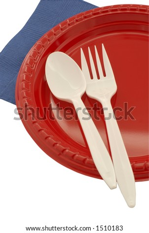 Plastic plate and flatware for a picnic - stock photo