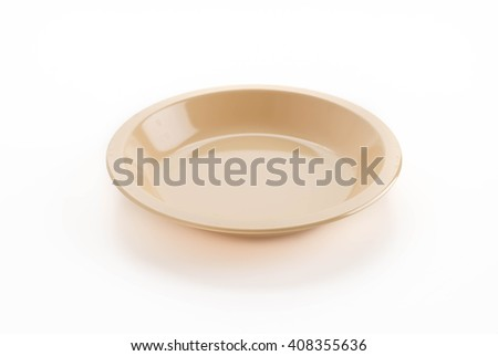 plastic plate on white background - stock photo