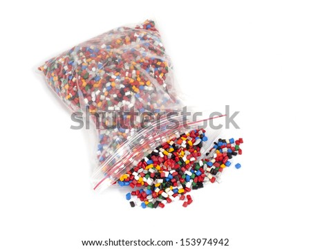 plastic polymer granules packet on white background - stock photo