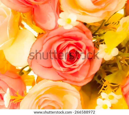 Plastic rose flowers with vintage filter - stock photo