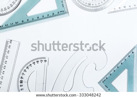 Plastic rulers on a white background - stock photo