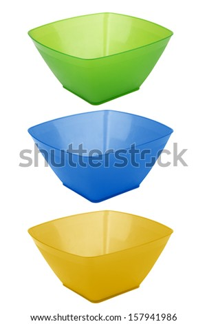 Plastic salad dish of various colors isolated on a white background - stock photo