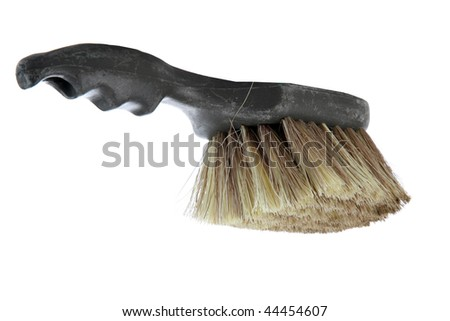 plastic scrub brush isolated on white with room for your text