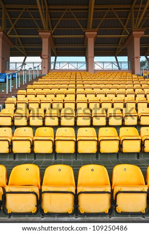 plastic seats at stadium - stock photo