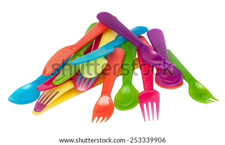 Plastic spoons, knives, forks of different flowers isolated on the white - stock photo