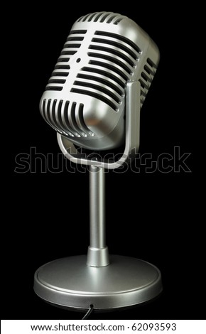 plastic studio microphone metallic color on pedestal, side view, isolated on black - stock photo