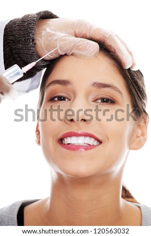 Plastic surgeons giving botox injection in female skin. Isolated on white