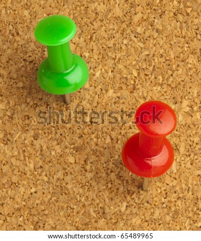 plastic thumbtack on cork billboard extreme closeup - stock photo