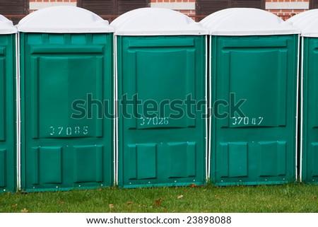Plastic toilet on the street in autumn - stock photo