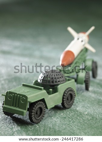plastic toy missile with carrier - stock photo