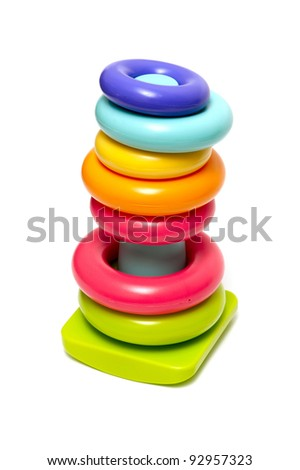 Plastic toy pyramid on a white background - stock photo