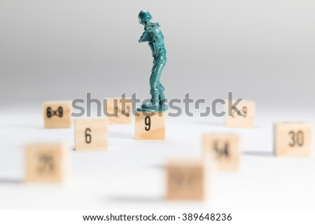 Plastic Toy Soldiers and wood block - stock photo