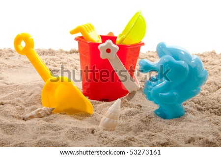 plastic toys for beach on sand over white background