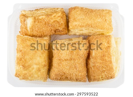 Plastic transparent box with flaky biscuits isolated on white background, top view - stock photo