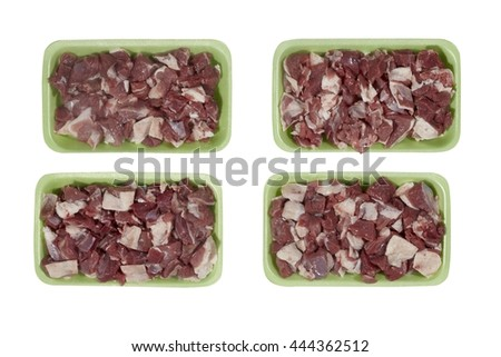 Plastic tray with lamb meat isolated on white background. Top view