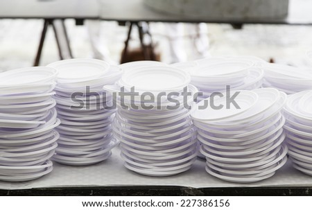 Plastic trays for a party, a detail of dinner plates, disposable tableware - stock photo