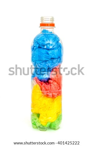 Plastic water bottle full of plastic shopping bags isloated on white background. Concept image for polluting water and oceans with plastic waste. - stock photo