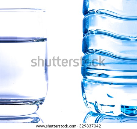 Plastic water bottle with a glass, isolated on white