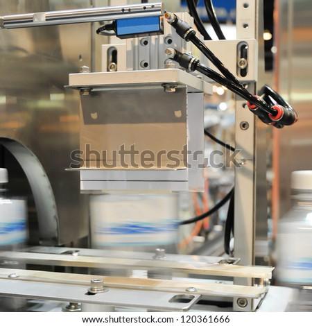 Plastic water bottles on conveyor - stock photo