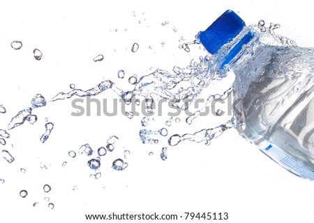 Plastic Water Bottles with water splashing - stock photo