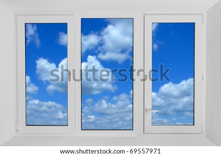 Plastic window with view to blue sky - stock photo