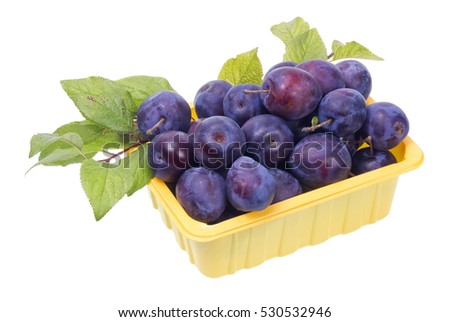 Plastic yellow industrial box with real natural blue fruits berries. Isolated
