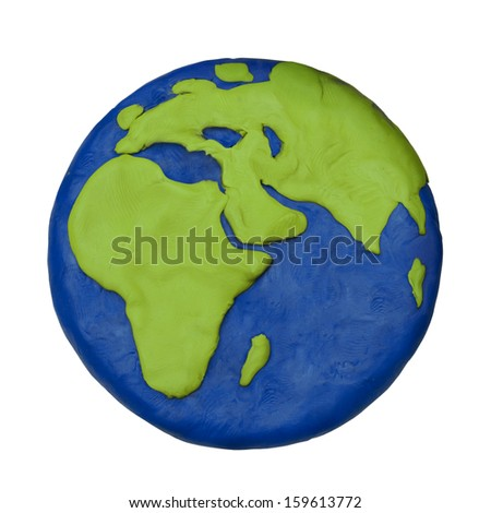 Plasticine child hand made planet earth Europe Africa part on a white background - stock photo