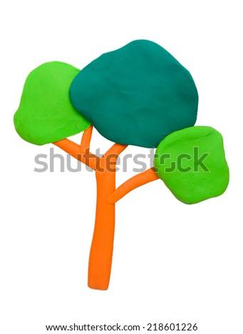 Plasticine clay tree on white background - stock photo