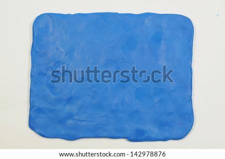 Plasticine finger textured blue background - stock photo