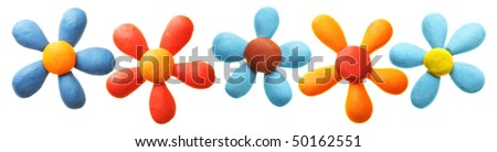 Plasticine flowers in a row isolated over the white background - stock photo