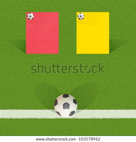 Plasticine football with referee cards on grass background