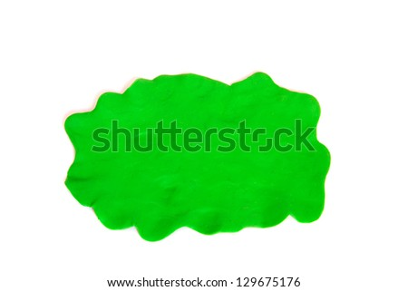 Plasticine green background free-form isolated on white. - stock photo