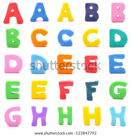 "plasticine letters standing on white background (1 of 3 - from ""a"" to ""h"") - stock photo"