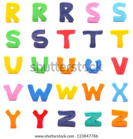 "plasticine letters standing on white background (3 of 3 - from ""r"" to ""z"") - stock photo"