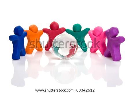 plasticine people chain surrounding a crystal globe - stock photo