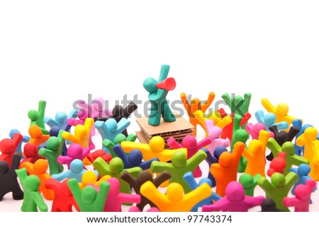 plasticine speaker standing on podium talking to his crowd through red megaphone - isolated on white