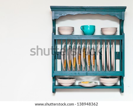Plate and bowl rack in a cottage kitchen - stock photo