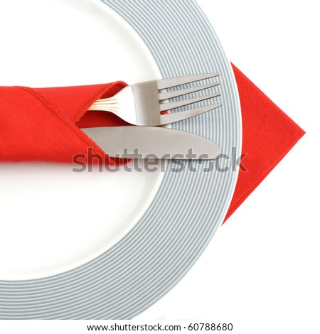Plate and cutlery on white. - stock photo