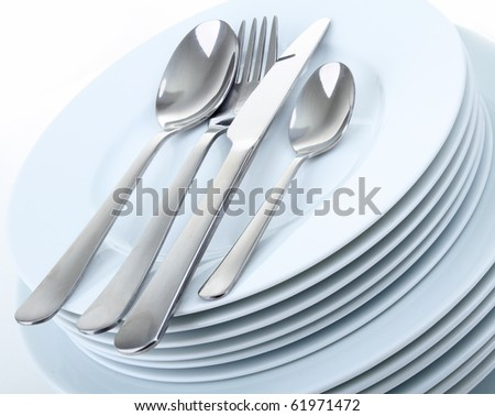 plate and cutlery on white - stock photo
