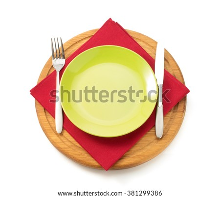 plate and fork with knife at napkin cloth on white background - stock photo